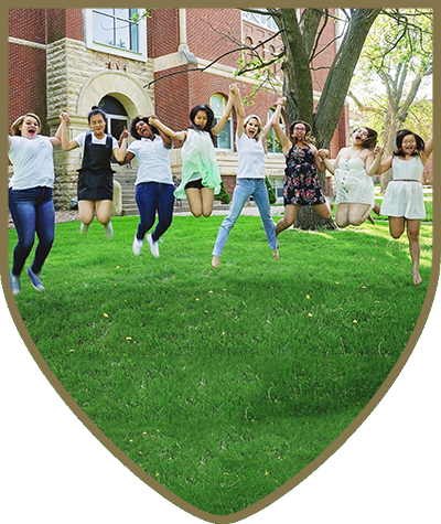 Camper Jumping for Joy at Pillsbury College Prep Summer Camp - Camp Pillsbury