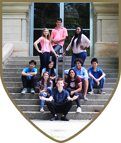Students pose on steps outside Pillsbury College Prep a U.S. Boarding School